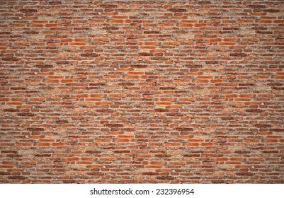 red brick wall or old dark brown, orange brick fences, grungy rusty blocks of stone work for texture and background