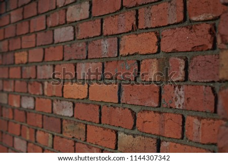 Red brick wall signifying