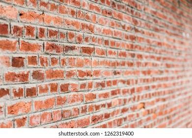 Red brick wall surface in perspective