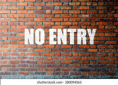 Red Brick wall texture background with a word No Entry