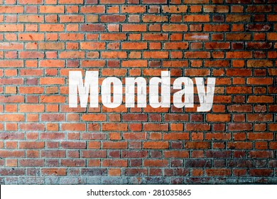 Red Brick wall texture background with a word Monday