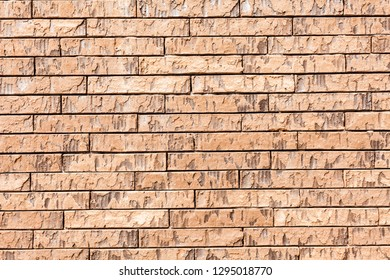 red brick wall texture grunge background with vignetted corners, may use to interior design. Old orange brick