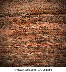 red brick wall texture grunge background with vignetted corners to interior design