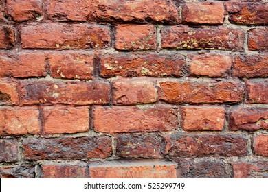 Red brick wall texture grunge background. Close up retro brickwork texture
