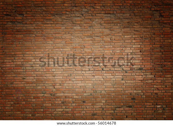 red brick wall texture photo image with central light effect