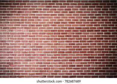Red brick wall with vignette at corners