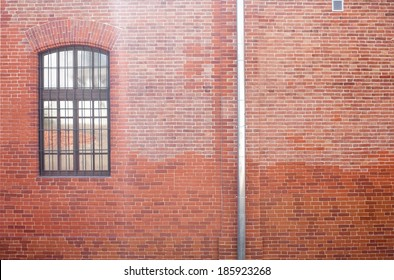 Red brick wall with vintage window