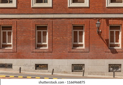 Red brick wall and windows on a street