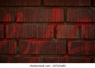 Red brick wall with writing
