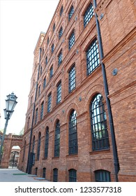 Red brick walls of revitalized 19th century factory 'Manufaktura' in Lodz, Poland. Architecture of the city of Lodz.