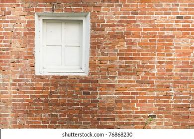 red brick and white window