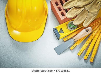 Red brick working gloves plastering trowel construction level wo