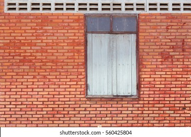 red bricks background and white windows