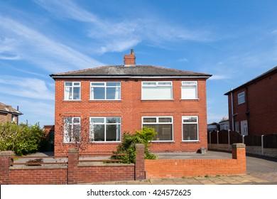Red bricks semi detached house, english village