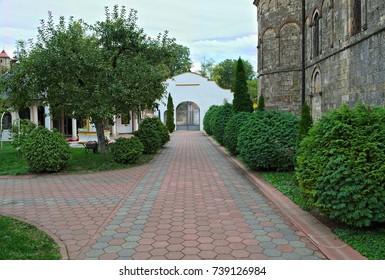 Red bricks sidewalk leading to gate in Serbian monastery