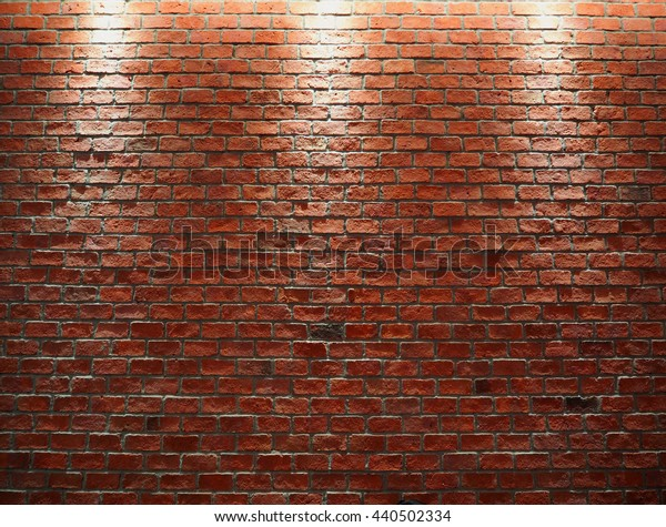 Red bricks wall with 3 Down light.