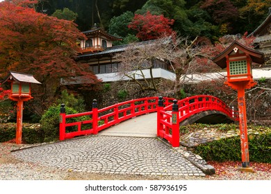 Red bridge with Autumn colors at Minoo Takianji temple in Osaka, Japan