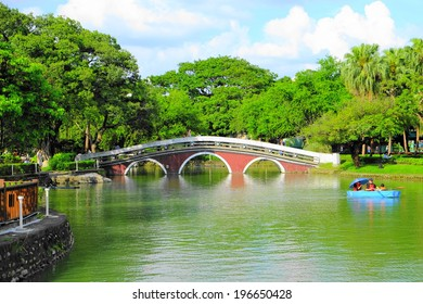 red bridge and green lake at Taichung Park