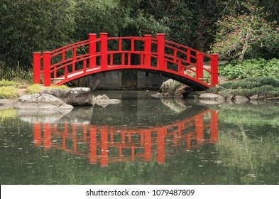 A Red Bridge spans a pond in the Birmingham Botanical Gardens in Birmingham,Alabama