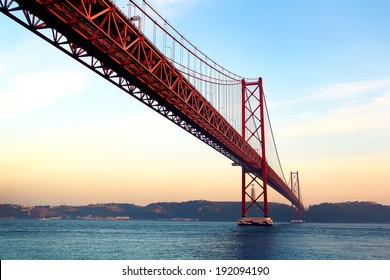 Red bridge at sunset, Lisbon, Portugal. Vintage style