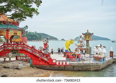 The Red Bridge at Tin Hau Temple and Kwun Yam Shrine at the Repulse Bay Beach in Hongkong