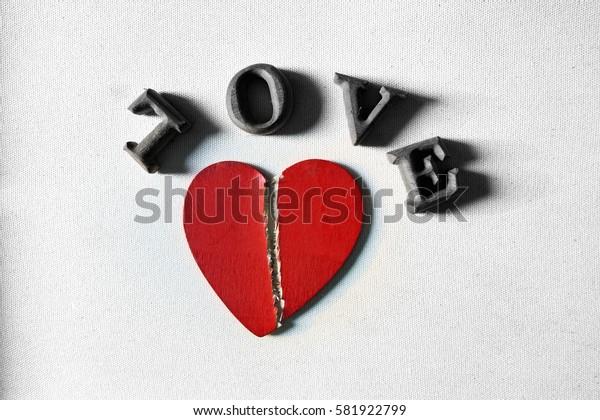 Red broken heart on white background