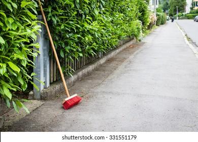 red broom on clean street in little german town, selective focus