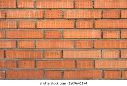 Red brown block brick wall Beautifully arranged texture background