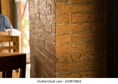 Red brown brick pole in coffee shop