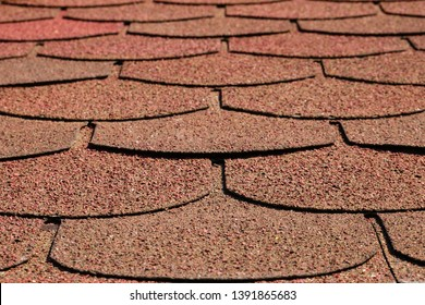 Red brown curved roof tiles in perspective. Textured background. Copy space