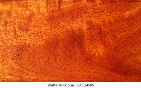 Red and brown, natural wood background. Texture of tropical wood.