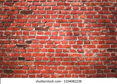 the red brown old brick wall
