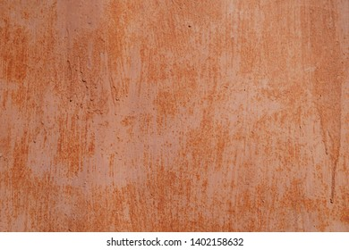 Red brown painted grunge metal garage wall background. Copy space