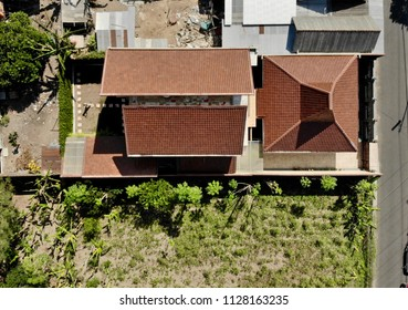 Red brown roof house in Aerial Photography top view
