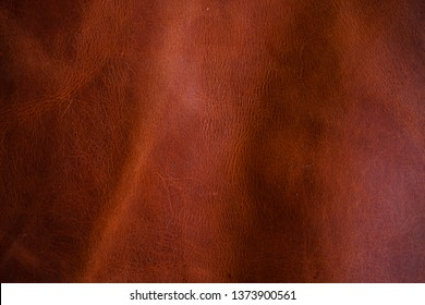 Red brown vegetable tanned cartier leather, Genuine cowhide background
