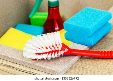 Red brush and blue sponge on kitchen sink.Cleaning concept