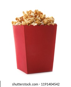 Red bucket with delicious caramel popcorn on white background