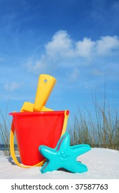 Red bucket and spade on the beach