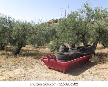 Red builders skips with rubber tires on wasteland near Alora Andalusia