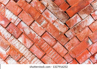 Red building brick texture of building brick folded into storage corners. Stacks of red bricks for construction purpose.