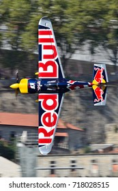 Red Bull Air Race 2017 Porto - Martin Sonka plane flying vertical against buildings background