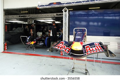 Red Bull Racing's front wing by the pit wall