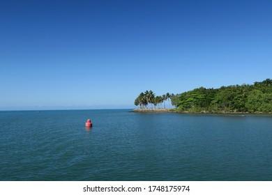 red buoy in calm sea in Port Douglas, Queensland, Australia