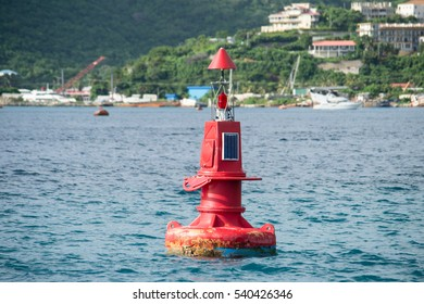 Red buoy channel marker for navigation in water
