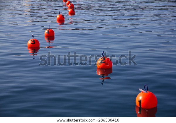 Red buoy on the sea for the Barcolana boat race event.