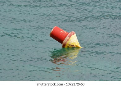 red buoy on water