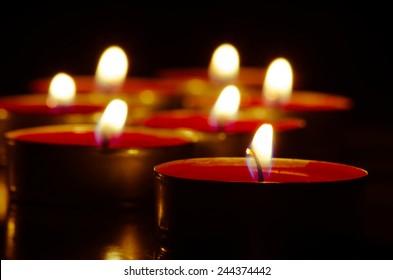 red burning candles image background