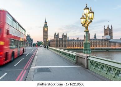 Red Bus speeds up along Westminster Bridge - London, UK.