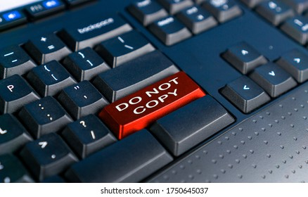Red button keyboard with DO NOT COPY text