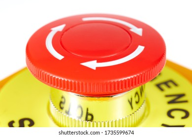 Red button in a yellow case with label EMERGENCY STOP.